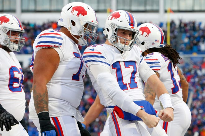 Buffalo Bills quarterback Josh Allen (17) reacts as teammates celebrate his touchdown run against the Jacksonville Jaguars during the second half of an NFL football game, Sunday, Nov. 25, 2018, in Orchard Park, N.Y. (AP Photo/Jeffrey T. Barnes)