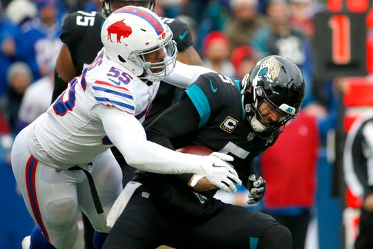 Jacksonville Jaguars quarterback Blake Bortles (5) is sacked by Buffalo Bills defensive end Jerry Hughes (55) during the first half of an NFL football game, Sunday, Nov. 25, 2018, in Orchard Park, N.Y. (AP Photo/Jeffrey T. Barnes)