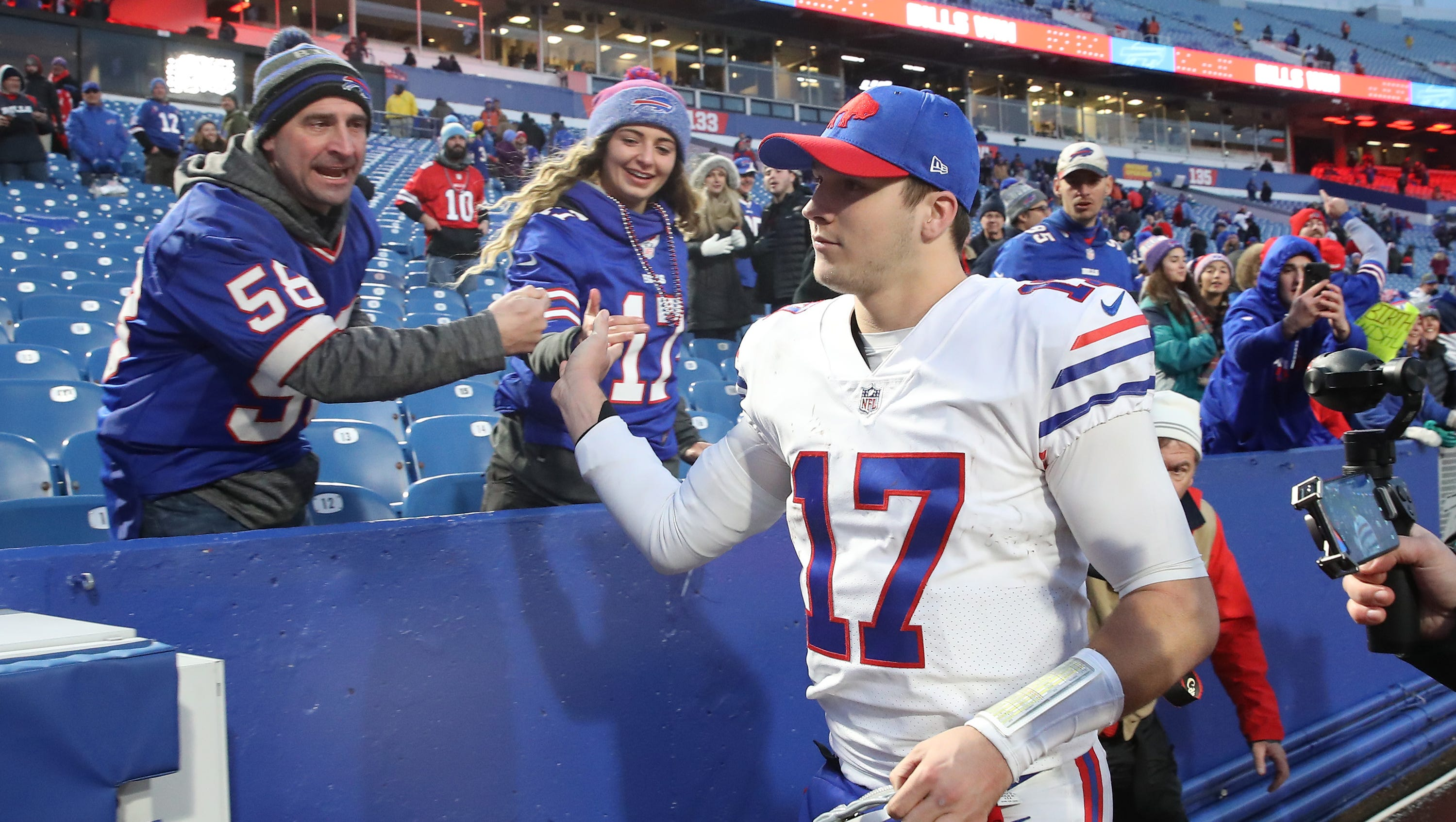 BUFFALO, NY - NOVEMBER 25: Josh Allen #17 of the Buffalo Bills celebrates their victory with fans during NFL game action against the Jacksonville Jaguars at New Era Field on November 25, 2018 in Buffalo, New York. (Photo by Tom Szczerbowski/Getty Images)