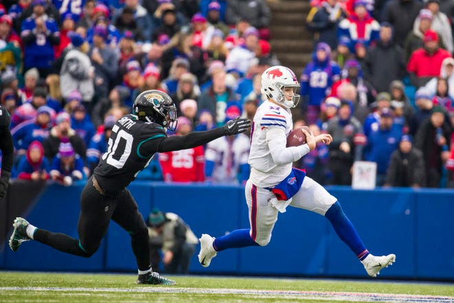 ORCHARD PARK, NY - NOVEMBER 25:  Josh Allen #17 of the Buffalo Bills slides at the end of a run as he avoids Telvin Smith #50 of the Jacksonville Jaguars during the second quarter at New Era Field on November 25, 2018 in Orchard Park, New York.  (Photo by Brett Carlsen/Getty Images)
