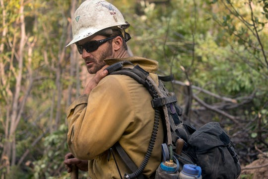 Kenn Boles, a member of a Bureau of Land Management fire crew out of Lakeview, Oregon, works on the Cougar Creek Fire in central Washington state in August.
