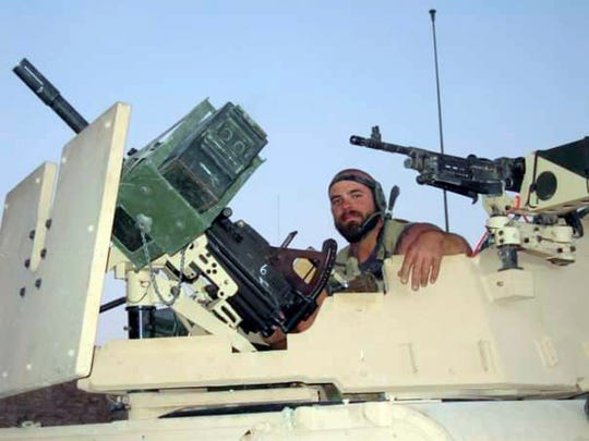 This 2007 photo shows Christopher Schott in northern Kandahar Province in Afghanistan. BLM's Lakeview Crew 7 is comprised almost entirely of U.S. military veterans like Schott.
