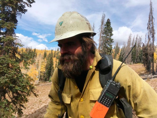 Christopher Schott works in Utah with a firefighting crew out of Lakeview, Oregon. After being in firefights in Afghanistan and Iraq, members of the new elite crew from Lakeview are bringing their military experience to bear as they battle wildfires in the most rugged country back home.