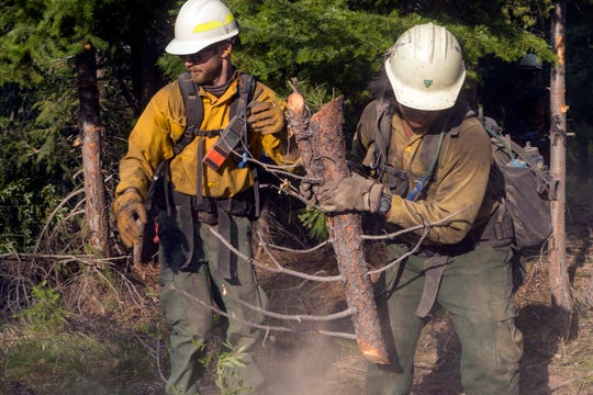 Members of a Hot Shot fire crew out of Lakeview Oregon works on the Cougar Creek Fire in central Washington state.