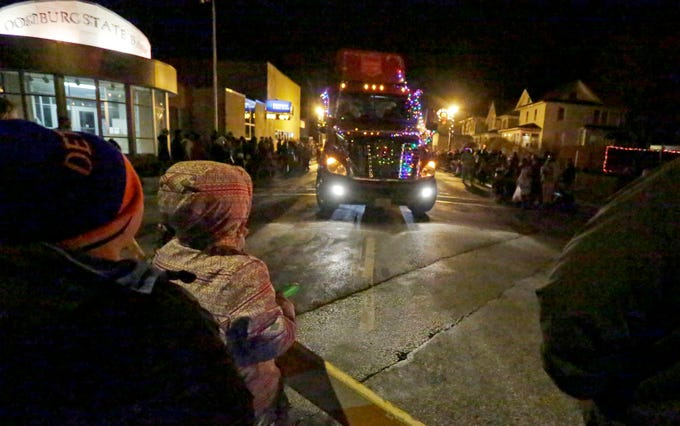 Children and adults watch the Oostburg Christmas Parade, Saturday, November 24, 2018, in Oostburg, Wis.