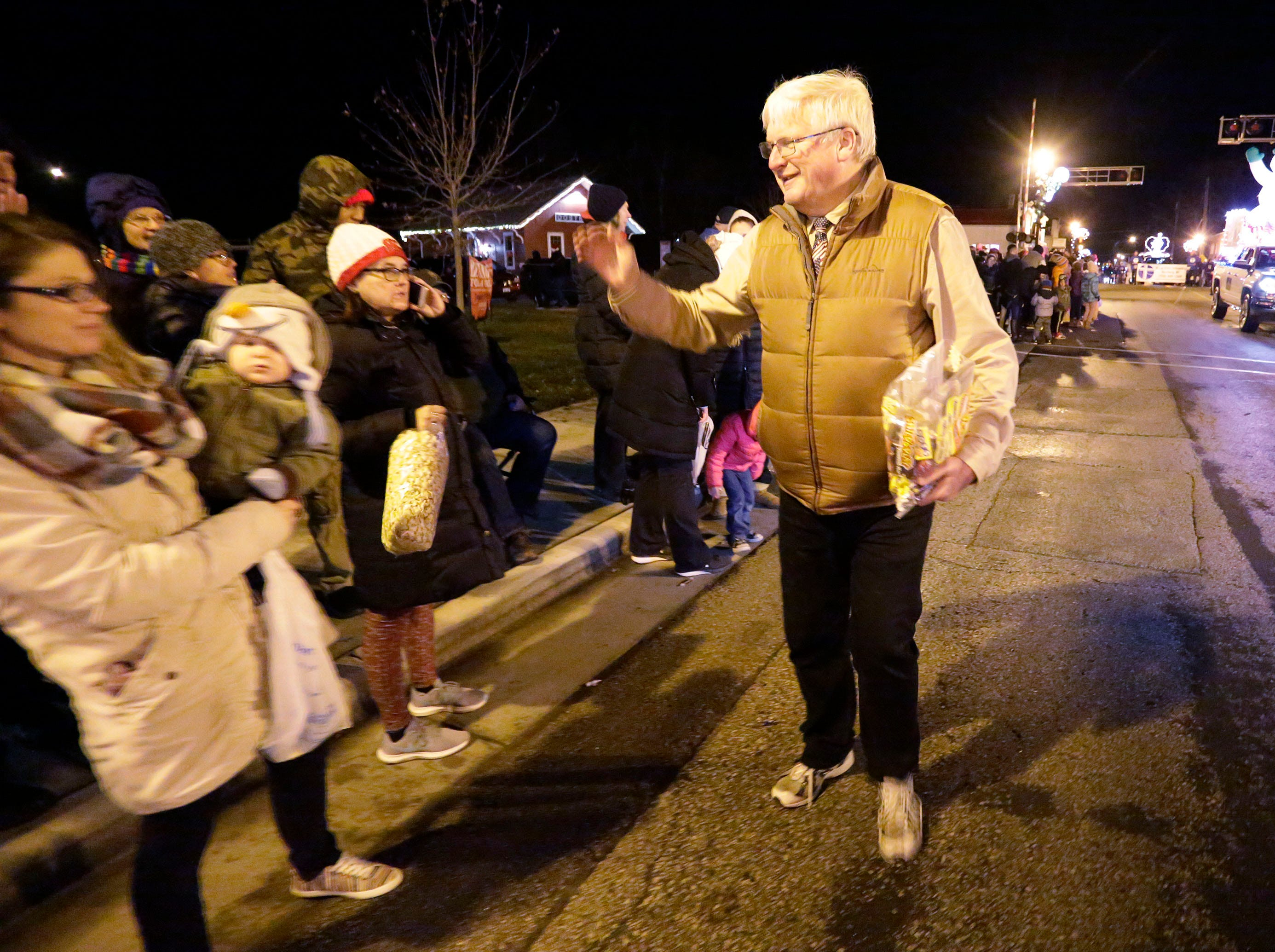 U.S. Representative Glenn Grothman waves to people along the route at the Oostburg Christmas Parade, Saturday, November 24, 2018, in Oostburg, Wis.