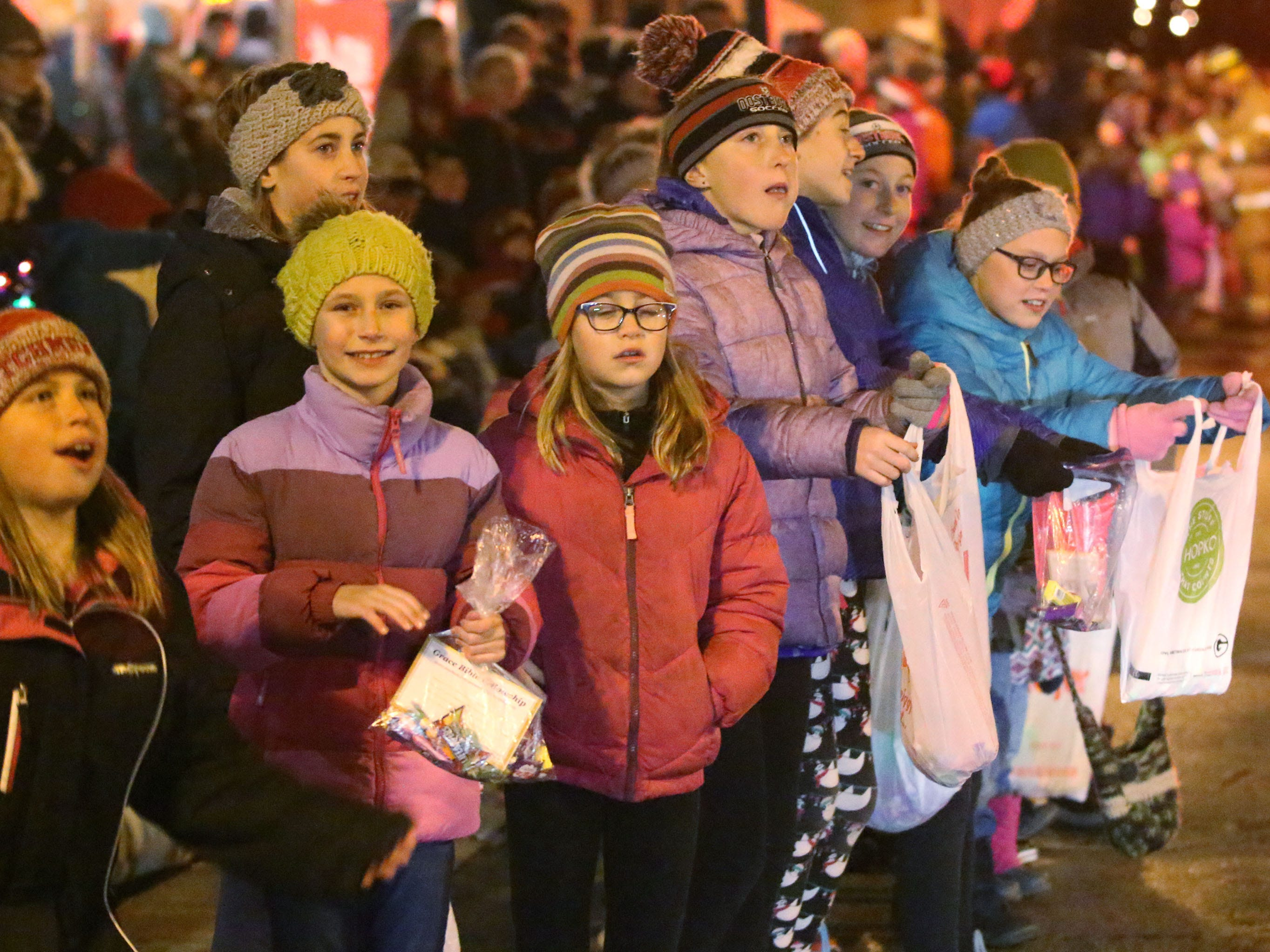 Children came prepared with bags for candy to be distributed at the Oostburg Christmas Parade, Saturday, November 24, 2018, in Oostburg, Wis.