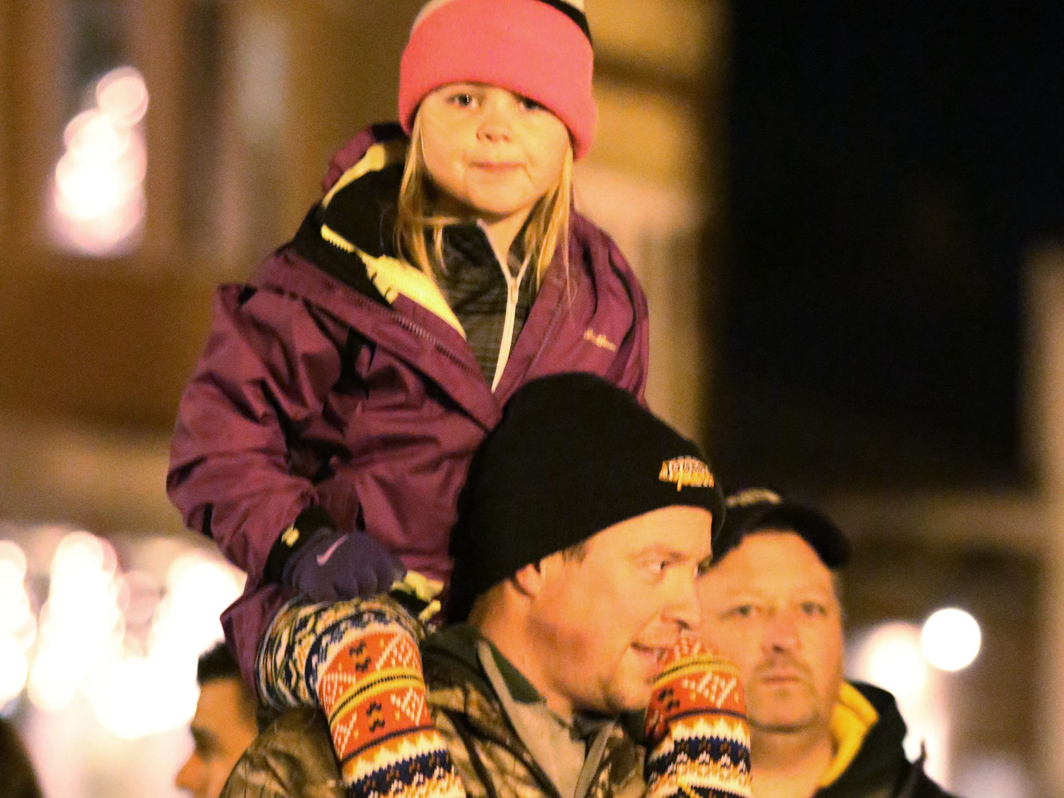 Jake Ratajczak of Oostburg, lets his daughter Nora, 5, have a better view at the Oostburg Christmas Parade, Saturday, November 24, 2018, in Oostburg, Wis.