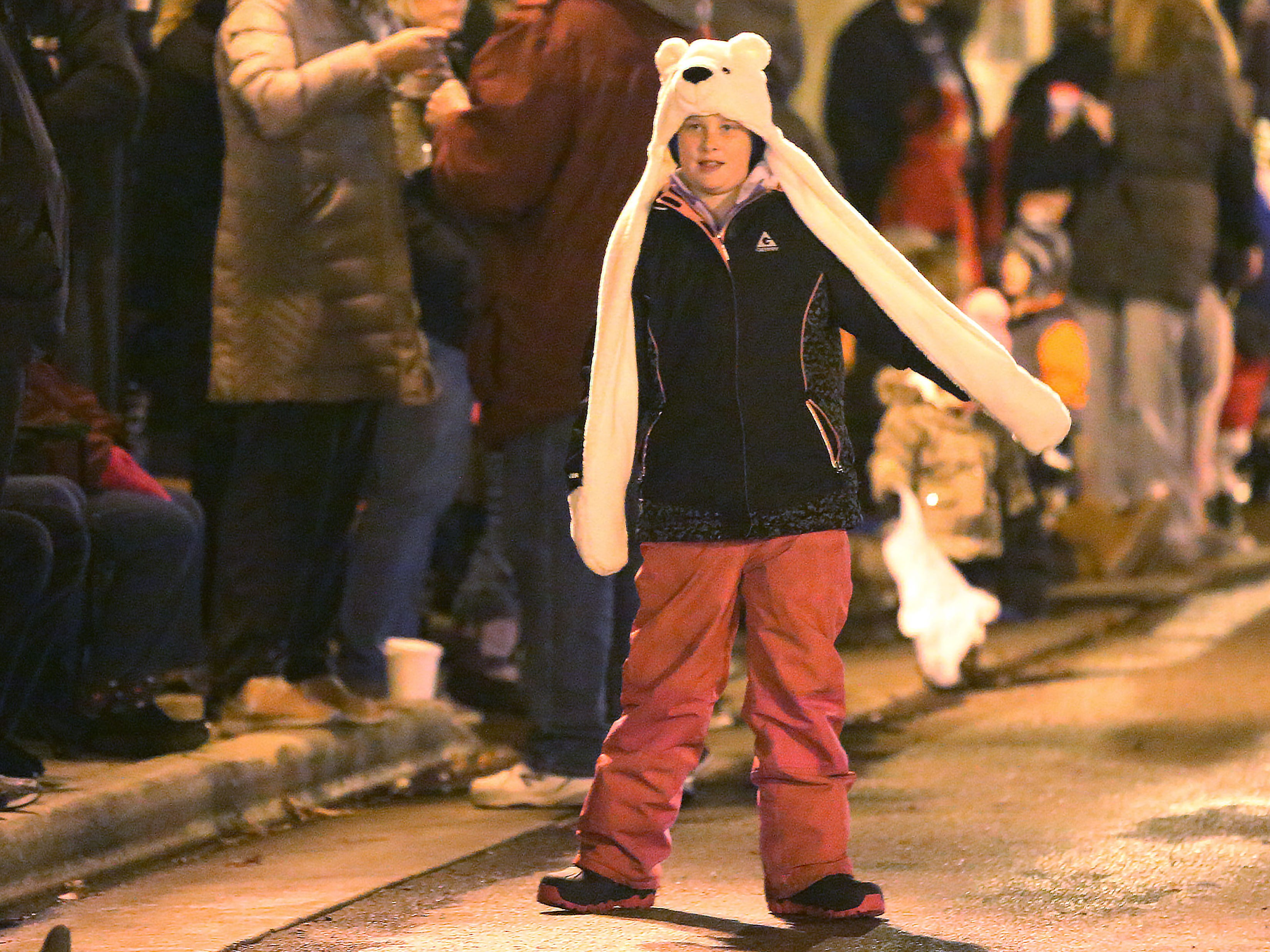 Sabrina McAlpine, 10, of Hingham, Wis., waits for the Oostburg Christmas Parade, Saturday, November 24, 2018, in Oostburg, Wis.