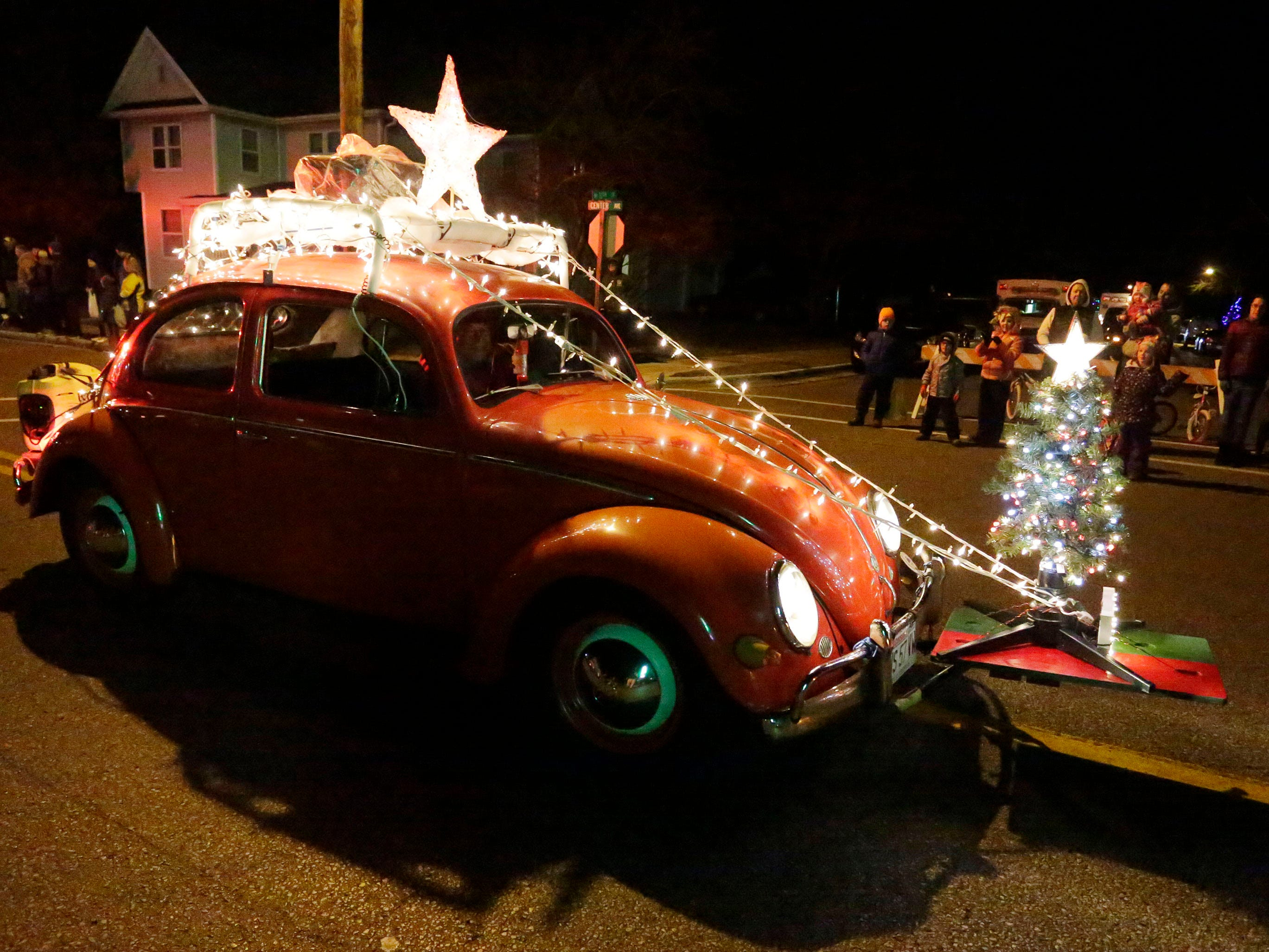 David Weinhold of Sheboygan Falls, Wis. drives his well lit Volkswagen Beetle during the Oostburg Christmas Parade, Saturday, November 24, 2018, in Oostburg, Wis.
