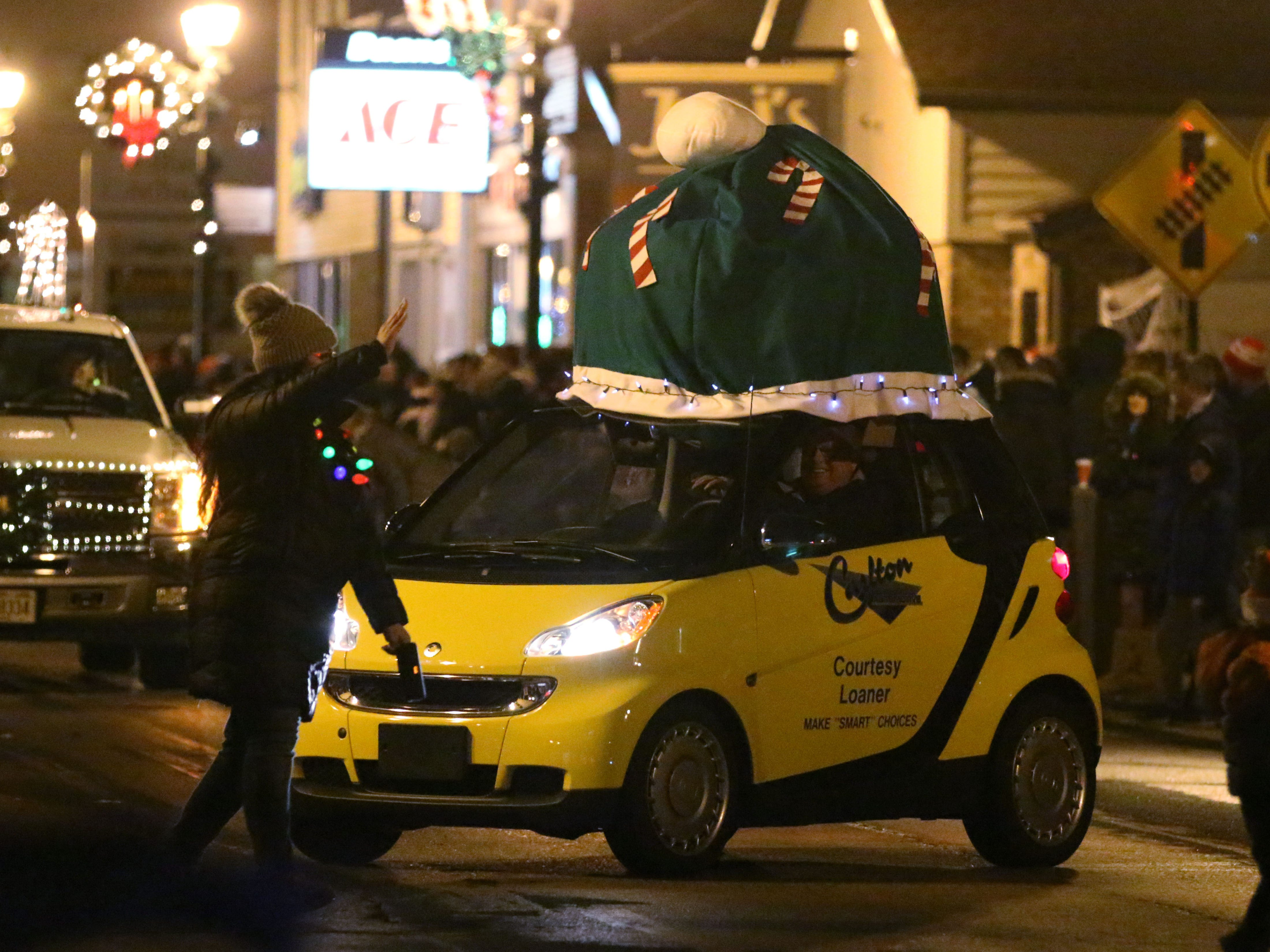 A Smart car had a hat on to stay warm during the Oostburg Christmas Parade, Saturday, November 24, 2018, in Oostburg, Wis.