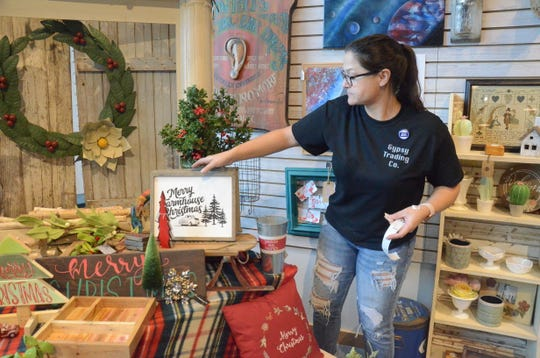 Gypsy Trading Compay owner Ellie Cutrer works on Small Business Saturday on Nov. 24.