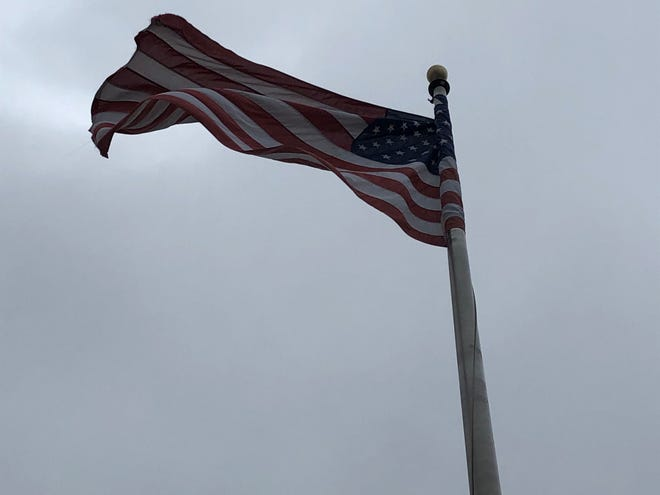 A flag blows in the wind Sunday in Springfield.