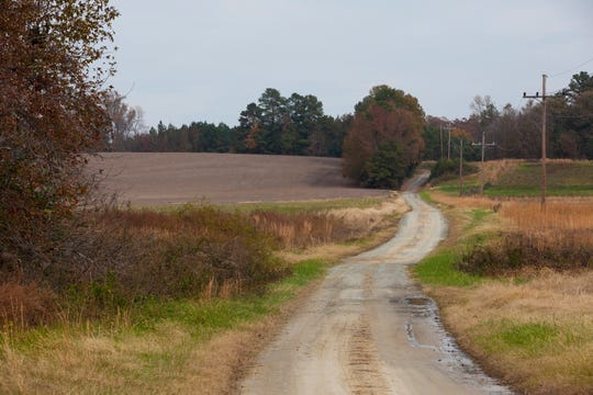 A farm road weaves through fields near Warsaw, Va., on Monday. The area once supported a Native American settlement belonging to the Rappahannock tribe; the tribe recently won federal recognition.