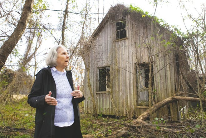 Archeologist Julia King stands in front of an abandoned home that was home to chiefs from the Rappahannock tribe. The home was built in late 1800s; it also doubled as a school and tribal gathering place.