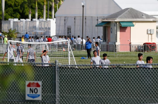 In this June 18, 2018, file photo immigrant children play outside a former Job Corps site that now houses them in Homestead, Fla. Records obtained by The Associated Press highlight some of the problems that plague government facilities for immigrant youth.