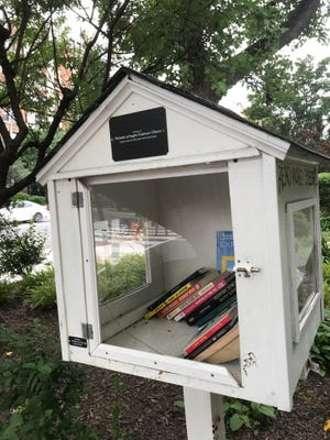 This Little Free Library, erected eight blocks from the White House and dedicated to former first lady Michelle Obama, has been vandalized and resuscitated several times.