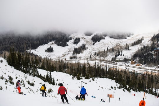 Snow clouds cover the peaks at Brian Head Resort Saturday, November 24, 2018. The resort is opening ski lifts over time, as weather allows.