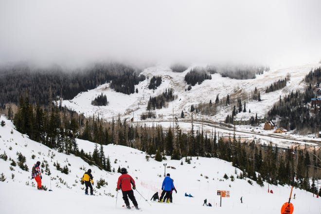 Snow clouds cover the peaks at Brian Head Resort Saturday, November 24, 2018. Utah ski fans might be glad to know that one of the country's oldest almanacs is predicting deep powder this coming winter.