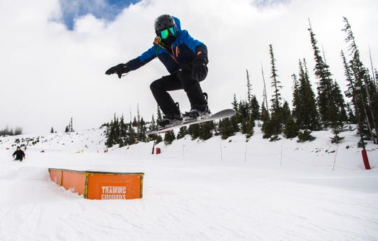A snowboarder shows off a trick at Brian Head Resort in this file photo from November 2018.