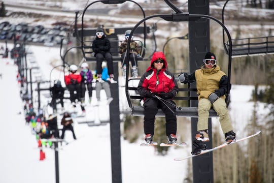 Brian Head Resort guests ride one of its ski lifts in this November 2018 file photo.