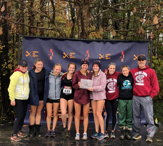Chiles' girls cross country team continued its unbeaten since by winning a Nike Cross Regionals Southeast title on Saturday, Nov. 24, 2018, at Wake Med Soccer Park in Cary, N.C. The Timberwolves also captured their second straight Class 3A state title three weeks ago. From left: Assistant coach Carly Thomas, Megan Churchill, Abby Schrobilgen, Emily Culley, Olivia Miller, Caitlin Wilkey, Lindsay James, Alyson Churchill, head coach Mike Phillips.
