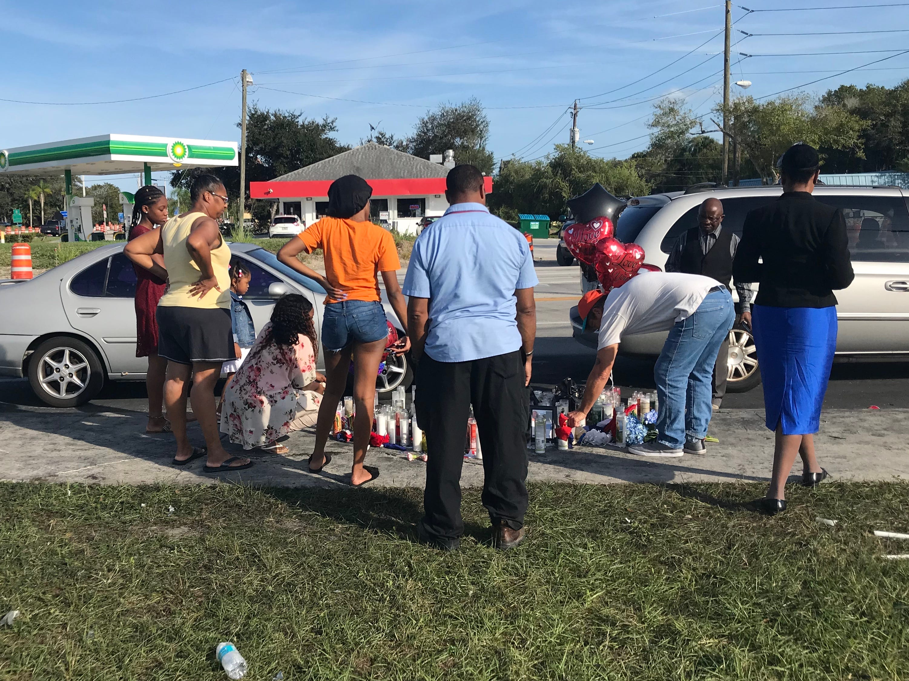 A roadside memorial grew Sunday for the five people killed late Black Friday in a fiery crash near Fort Pierce.