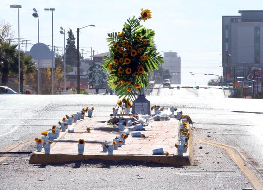 "Flowers adorn the median at North Mesa  Street and Cincinnati Avenue following the death of Amanda ""Mandy"" Weyant-Ferguson."
