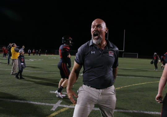Grace Brethren head coach Josh Henderson celebrates after the Lancers defeated Corona del Mar 26-14 at Royal High on Saturday night to capture the CIF-Southern Section Division 4 championship. It was the second straight CIF title for Grace Brethren, which won the Division 8 title last season.