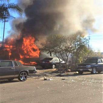 """""""Get out! Get out! Let's go, let's go,"""" an officer shouts to the occupants of an El Rio home after an explosion sets it ablaze."""