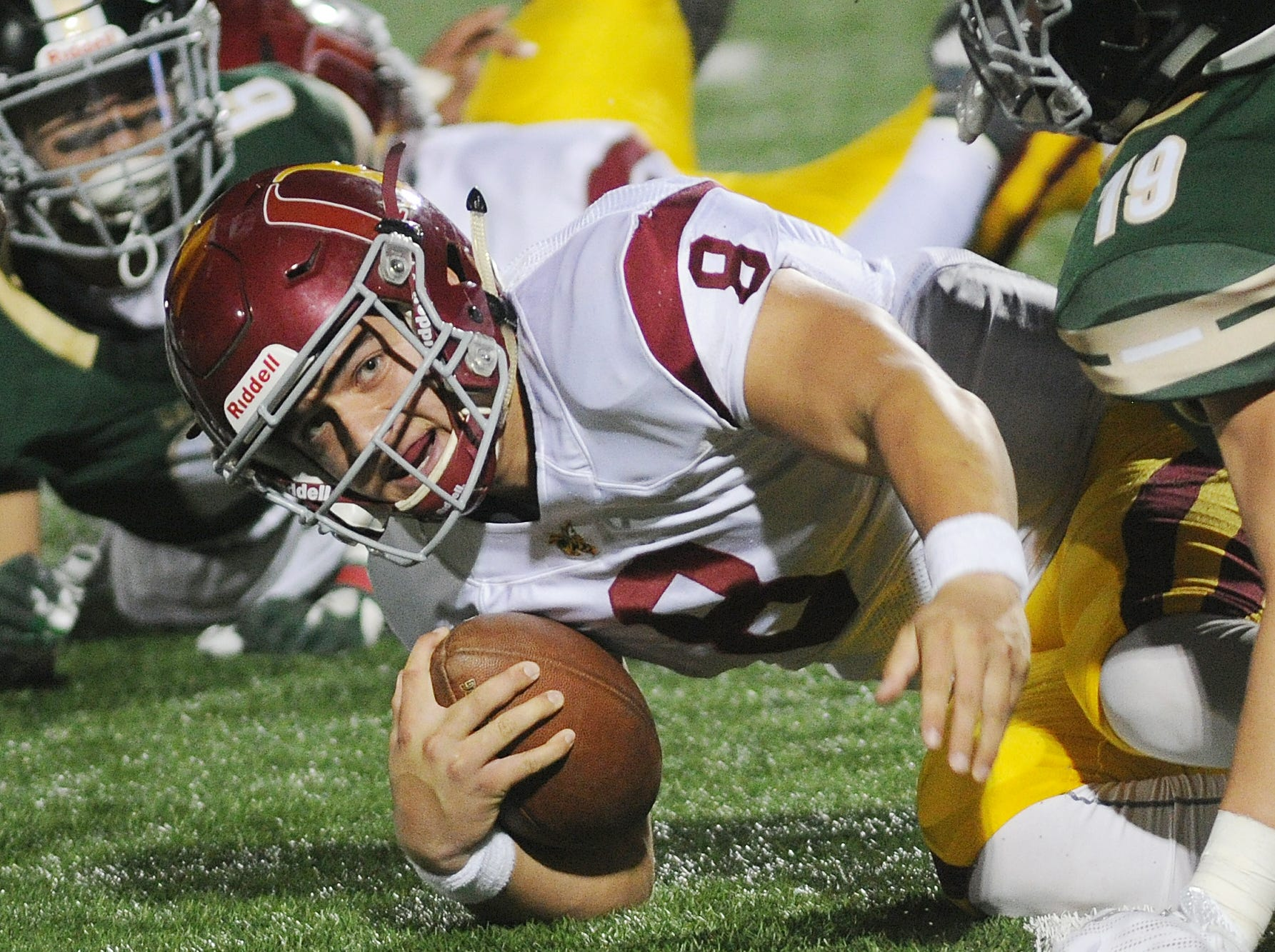 Oxnard quarterback Vincent Walea is sacked during the CIF-Southern Section Division 6 championship game at Covina District Stadium on Saturday night. Oxnard lost to South Hills, 24-13.
