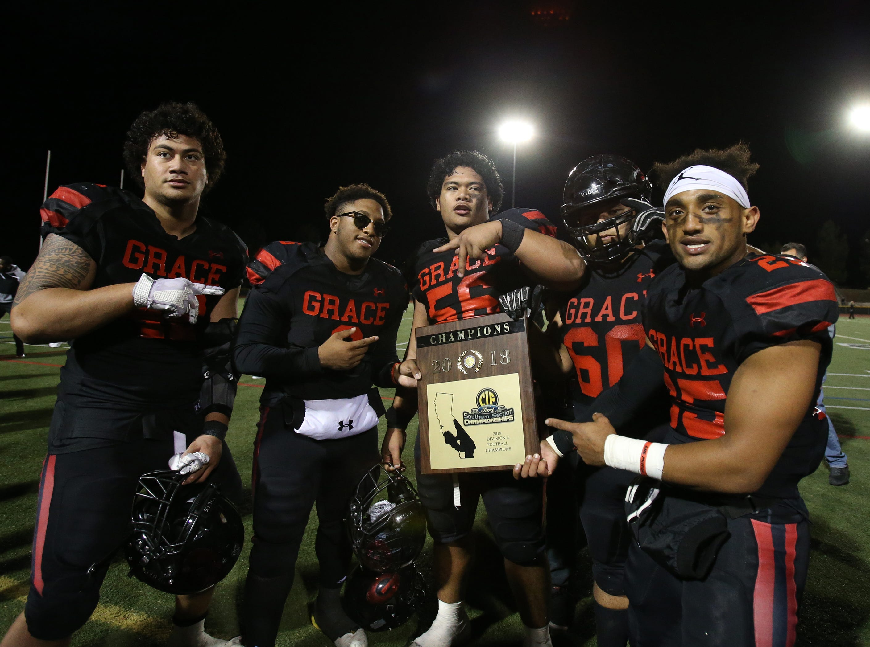 Grace Brethren's Stanley Taufoou (left to right), Lontrelle Diggs, Soane Toia, Sebastian Vega and Danny Whitt  proudly show the 2018 CIF-Southern Section Division 4 championship plaque after the Lancers defeated Corona del Mar 26-14 at Royal High on Saturday night.