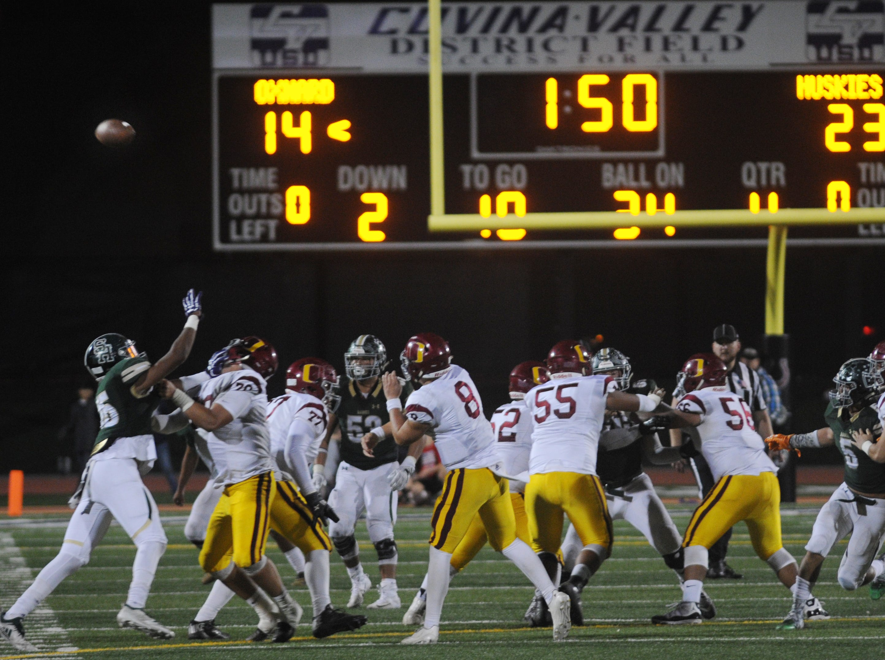 Oxnard High quarterback Vincent Walea  throws a pass late in the Yellowjackets' 24-13 loss to South Hills in the CIF-SS Division 6 championship game Saturday night at Covina District Field.