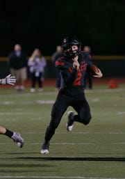 Grace Brethren quarterback Mikey Zele finds an opening to score the Lancers' third touchdown during their 26-14 win over Corona del Mar in the CIF-SS Division 4 championship game Saturday night at Royal High.