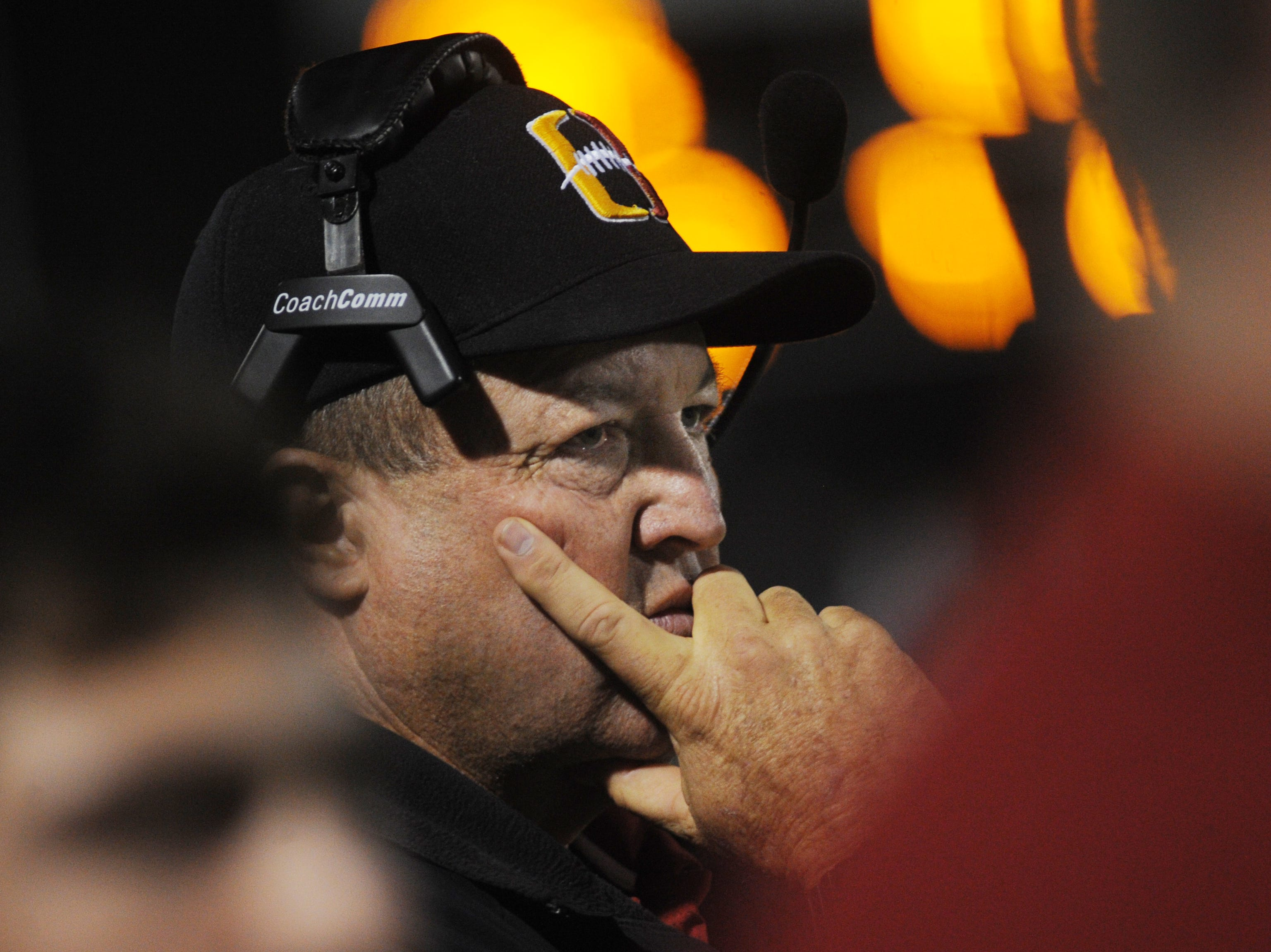 Oxnard High head coach Jon Mack watches the action during the Yellowjackets' 24-13 loss to South Hills in the CIF-Southern Section Division 6 championship game at Covina District Stadium on Saturday night.