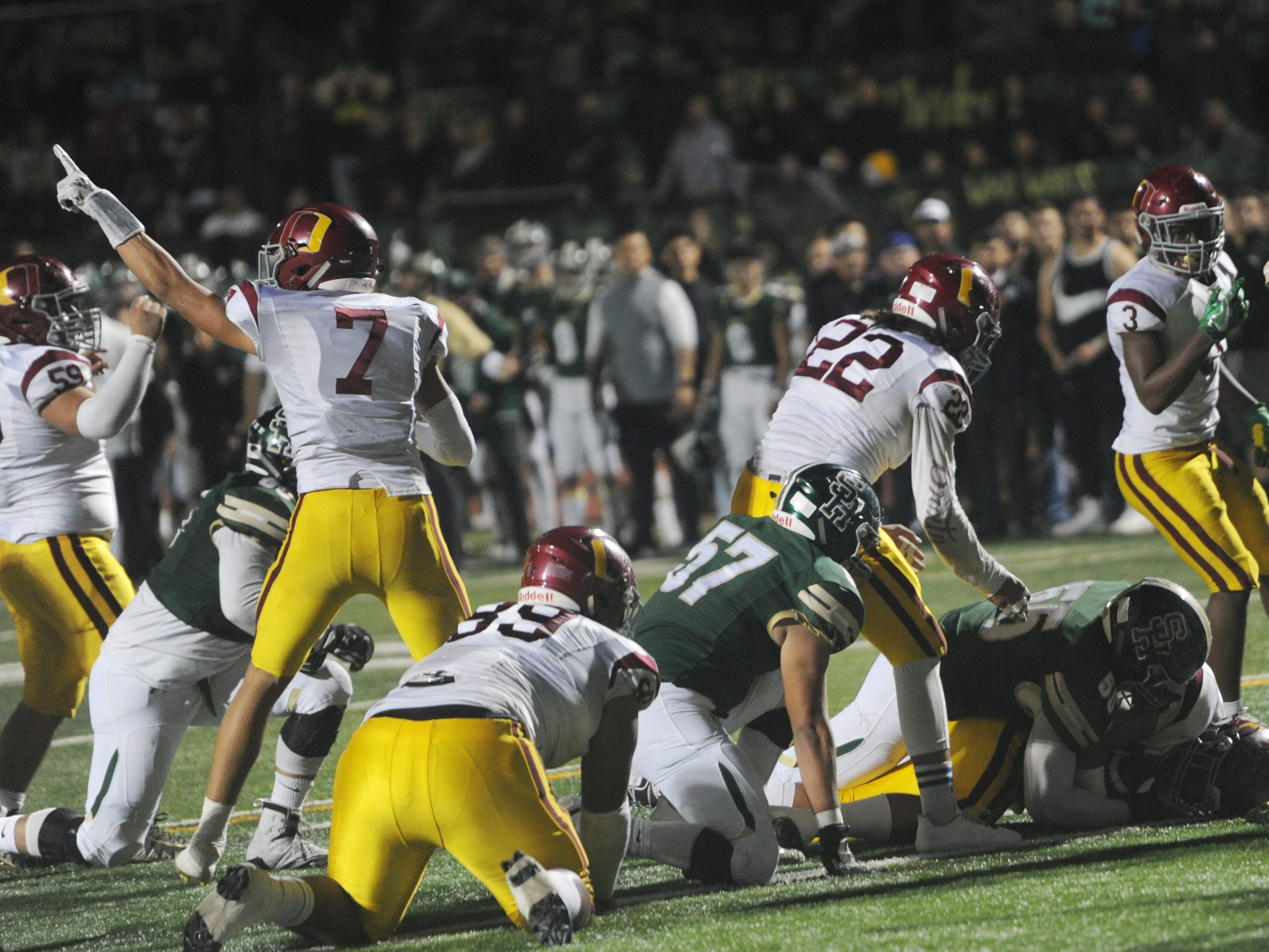 Tony Lopez (7) signals Oxnard's ball after the Yellowjackets recovered a South Hills fumble near their own end zone during the CIF-Southern Section Division 6 championship game at Covina District Stadium on Saturday night. Oxnard lost, 24-13.
