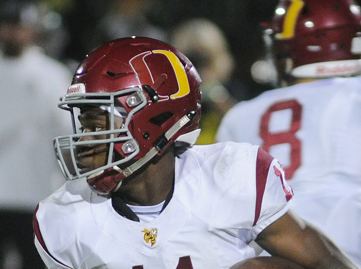 Oxnard High's Xavier Harris carries the ball against South Hills during the CIF-Southern Section Division 6 championship game at Covina District Stadium on Saturday night. Oxnard lost, 24-13.