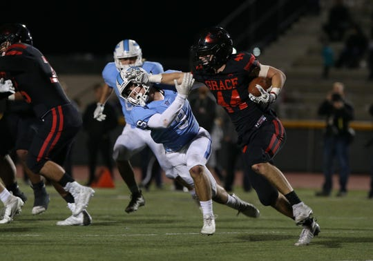 Grace Brethren's Josh Henderson pushes Corona del Mar's Luke Fisher out of the way during the Lancers' 26-14 win over Corona del Mar in the CIF-SS Division 4 championship game last Saturday night. The Lancers will play St. Augustine in the CIF-State Division 2AA SoCal Regional championship game Friday night at Cal Lutheran.