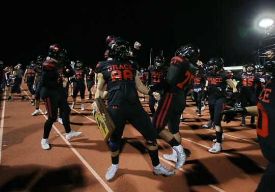 Grace Brethren players celebrate after after the Lancers defeated Corona del Mar 26-14 at Royal High on Saturday night to capture the CIF-Southern Section Division 4 championship. It was the second straight CIF title for Grace Brethren, which won the Division 8 title last season.