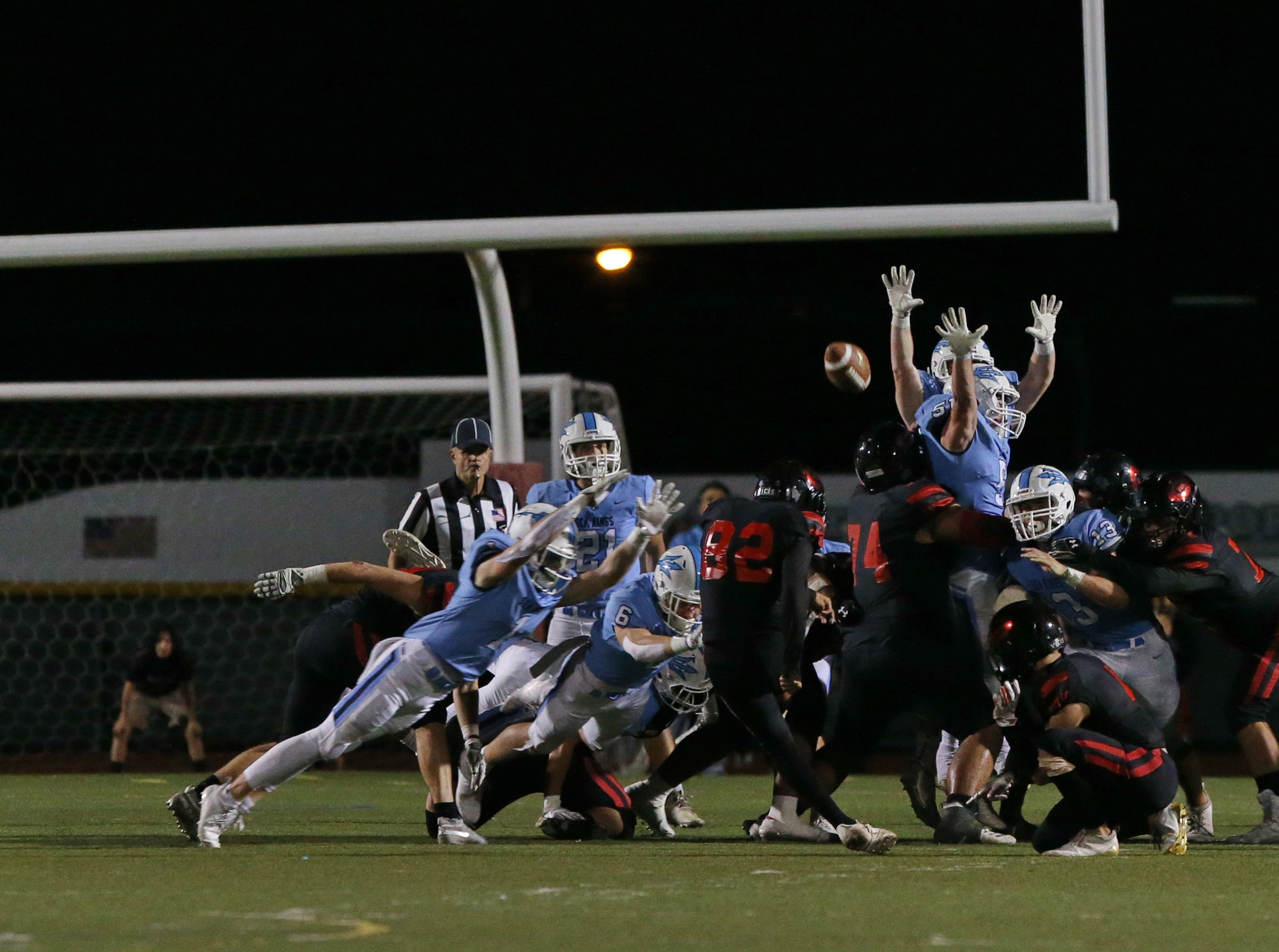 Kevin Aranda connects on a field goal to end the first half during Grace Brethren's 26-14 win over Corona del Mar in the CIF-SS Division 4 championship game Saturday night at Royal High.