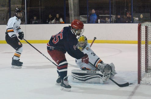 Stepinac's Stephen Stackhouse narrowly missed a goal in the first period of the Guy Mathews Thanksgiving Invitational at Ebersole on Saturday. He did score early in the second period to bring the Crusaders within 3-2.