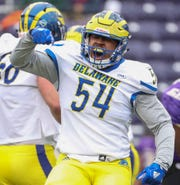 Delaware's Brandan Hall celebrates a sack in the first quarter of the Blue Hens' 20-6 loss at Bridgeforth Stadium during the opening round of the NCAA FCS playoffs Saturday.