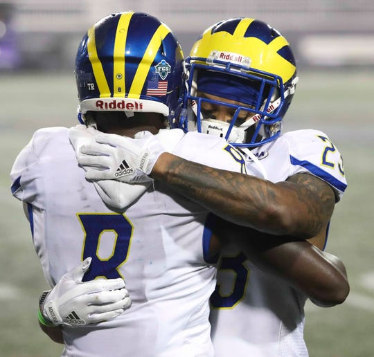 Delaware senior defensive backs Tenny Adewusi (left) and Nasir Adderley hug before leaving the field at the end of their college careers following the Blue Hens' 20-6 loss to James Madison at Bridgeforth Stadium during the opening round of the NCAA FCS playoffs Saturday.