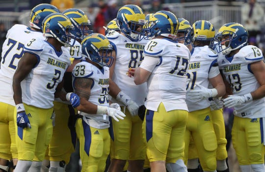 Delaware quarterback Pat Kehoe (12) leads his team in the huddle in the second quarter of the Blue Hens' 20-6 loss at Bridgeforth Stadium during the opening round of the NCAA FCS playoffs Saturday.