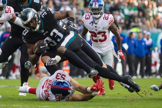 Eagles' Josh Adams (33) dives over New York's Connor Barwin (53) to get to the goal line Sunday at Lincoln Financial Field. The Eagles defeated the Giants 25-22.