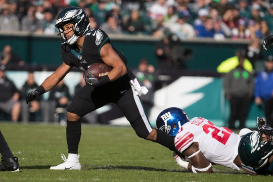 Eagles' Golden Tate (19) struggles to get away from New York's Landon Collins (21) Sunday at Lincoln Financial Field.