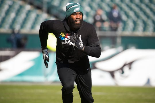 Eagles safety Malcolm Jenkins (27) warms up before the Eagles face the Giants Sunday at Lincoln Financial Field.