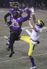 James Madison's Charles Tutt gets in front of a pass intended for Delaware's Vinny Papale for a fourth quarter interception in the Blue Hens' 20-6 loss at Bridgeforth Stadium during the opening round of the NCAA FCS playoffs Saturday.