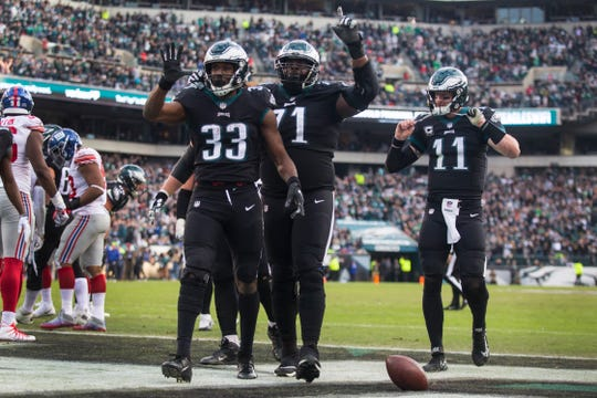 Eagles' Josh Adams (33) celebrates a touchdown Sunday at Lincoln Financial Field. The Eagles defeated the Giants 25-22.