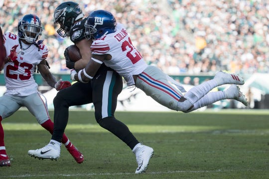 Eagles' Dallas Goedert (88) is wrapped up by New York's Landon Collins (21) Sunday at Lincoln Financial Field. The Eagles defeated the Giants 25-22.
